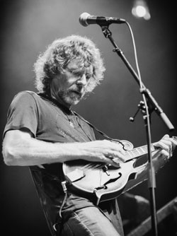 "Friday, September 4, 8:00 pmLocation: Colonial Theatre2050 Main StBethlehem, NHTicket: $68 Reserved, $52 General admission, $44 Members general admission.There may be no more uplifting sight in bluegrass than watching the irrepressible Sam Bush rock the stage.Founder of the rock/bluegrass fusion band, New Grass Revival, and innovator of the ""newgrass"" genre, Bush is a dynamic, joyous performer, and among the most entertaining artists in acoustic music. Masterful on mandolin and fiddle, Bush loves his music and his fans love him.Revered for both his solo and sideman work, which includes Emmylou Harris, Lyle Lovett, and Béla Fleck, he has soaked up honors such as an Americana Music Association Lifetime Achievement Award and suite of Grammys and International Bluegrass Music Association trophies, Bush still strives relentlessly to create something new.Raised on a farm just outside of Bowling Green, Kentucky, Bush grew up plowing tobacco fields in the Southern summer heat alongside his family. He started playing mandolin when he was 11 years old. ""I believe growing up on a farm probably helped me channel my energy into learning music and being so interested in it,"" Bush says. ""Me and my sisters, we all loved it. I've often wondered if that's because growing up on a farm, you couldn't go ride your bike all over town and horse around like the other kids."" For Bush, a lifetime of channeling his energy has led to stylistic innovations that have changed the course of bluegrass and roots music alike."
